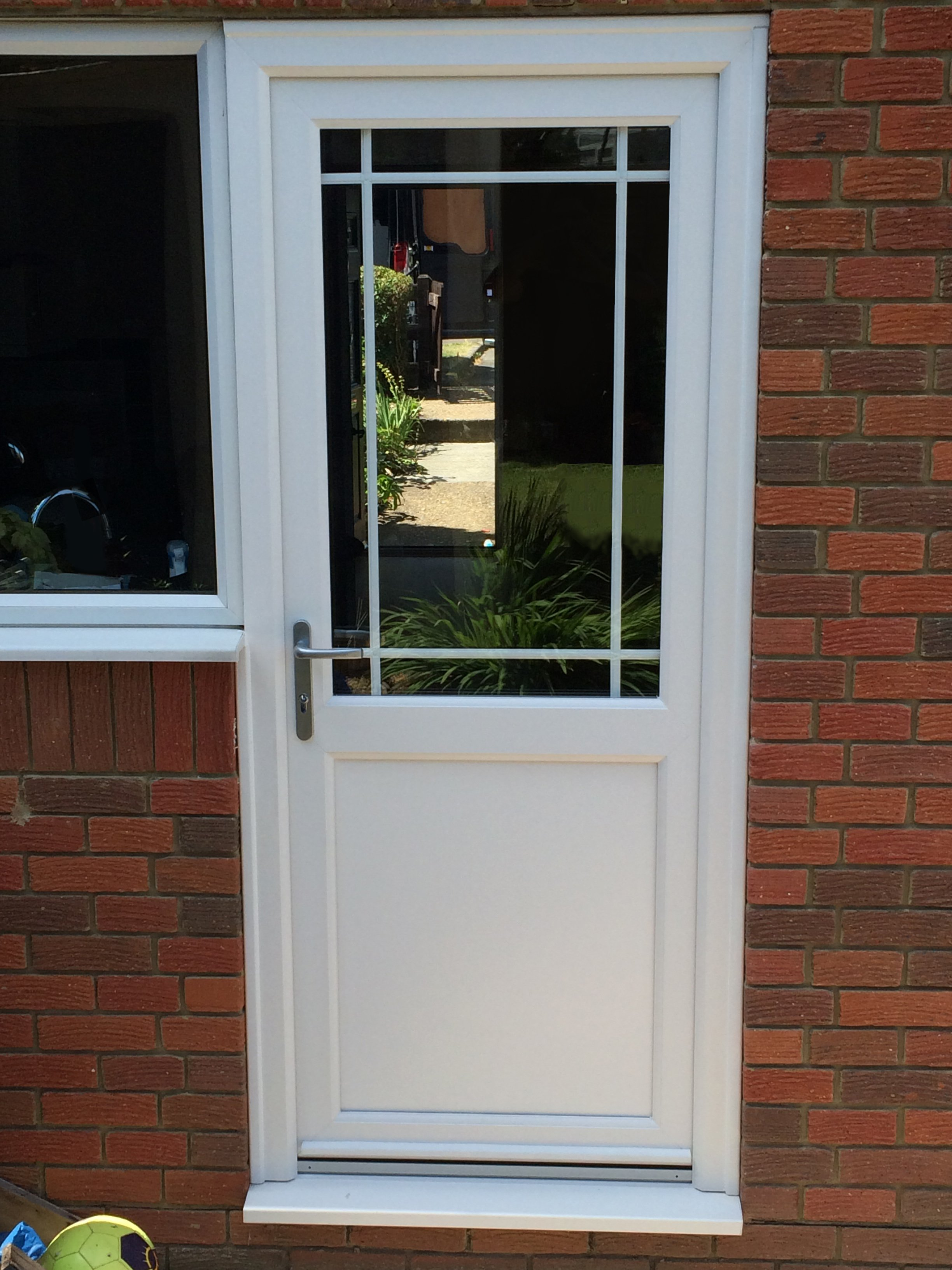 Fully fitted and supply only upvc composite doors by we for Back door with window that opens